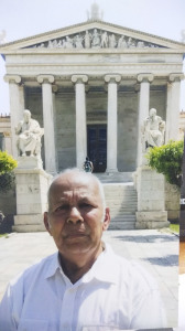 Sir infront of Athens Uni statues Plato n Socrates